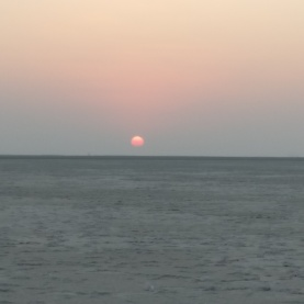 Sun setting over a sea of salt of